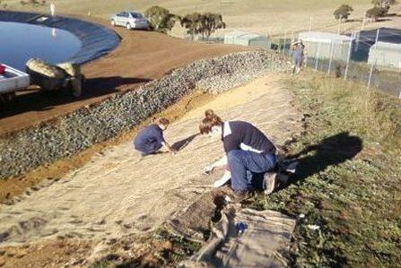 Laying matting before planting1